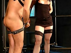 Mature hairy-ass slave getting strapped and ass-plugged by a beautiful mistress in stockings