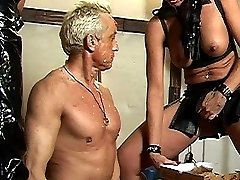 Submissive slave guy is force-fed