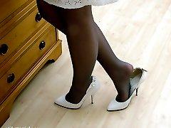 Hot blonde wearing white high heels and black stockings