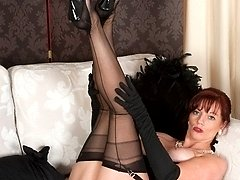 Sophisticated, redhead Holly in black lingerie, panties and ff nylons!