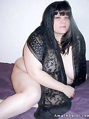 Busty fat brunette in black lace