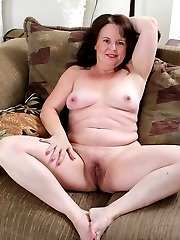 Curvy housewife Felicia McDonald spreads hairy pussy.