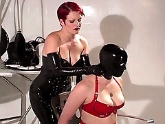Sexy mistress Sovereign Sonya plays with her cuffed latex slave