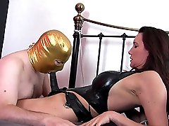 After fucking her masked slaves mouth with a big strapon, Jane then asks him to cum on her red...