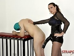 Strapon Jane fucks her submissives face with her strapon before unleashing the big gun on his...