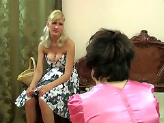 Sissy in a glossy satin dress goes for anal feast with a strap-on armed gal