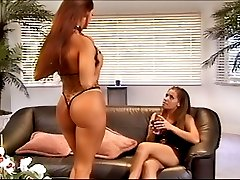 Two busty sexy lesbians anal strapon dildo fucking on couch