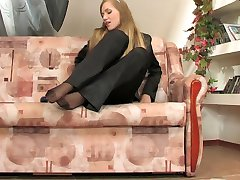 Footsy babe stroking her pussy through torn pantyhose before dildotoying