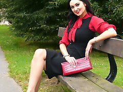 Sexy Maria teases her hot long legs and shiny red stiletto heeled shoes in the park