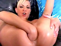 Blonde babe fisting herself in both holes