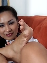 Amys stockinged feet in gold sandals!