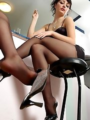 Red hot babes dangling her black shoes longing to taste yummy nyloned toes