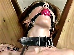 A girl in red pants is bound and whipped