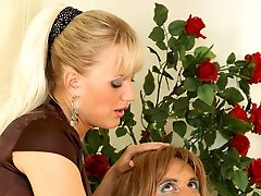 Freaky sissy in openwork lingerie bouncing on a babes strap-on like hell