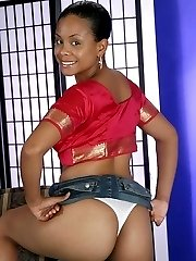 Stunning ebony exposes her natural boobs and moves her panties aside to show off her hairy pussy