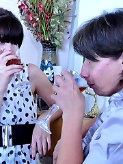 Dolled-up older and younger lesbians launch into drunken strap-on fucking