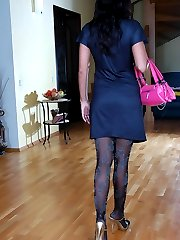 Dark-haired babe tries on expensive fashion hosiery after taking a shower