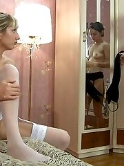 Stocking-clad blonde and brunette enjoy lesbian strap-on sex in the morning