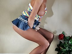 Tall and busty cock-teaser flaunting her mile-long pantyhose covered legs