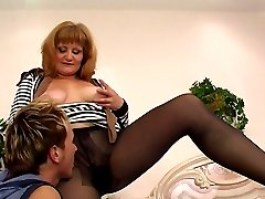 Sultry mature babe in sheer-to-waist pantyhose putting her ass in the air