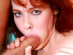 Redhead MILF gets her bright red bush filled with cock!