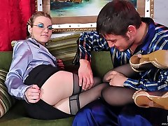 Luscious chick in black stockings takes a meaty cock up her warmed up ass