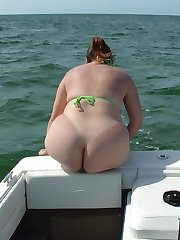 Chubby nudist women in a boats