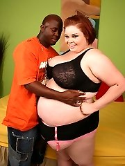 Thick BBW Candice Cane working a black rod with her mouth before taking it deep into her snatch...