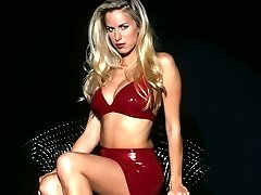 Red latex clinging to her hot blonde body