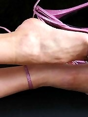 Glamorous junkie mistress gives you her high heeled feet to kiss