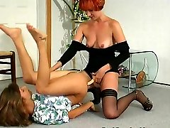 Redhead lesbian babe fingering tight ass before strap-on screwing on floor