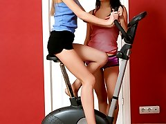 Tow babes fuck on an exercise bike