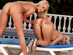 Two bikini babes enjoy cunnilingus