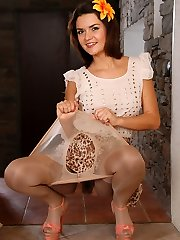 Adorable cutie with a hairy pussy peels off her layered tights one by one