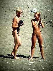 Spy cams film a sunny story of nude fun on a beach