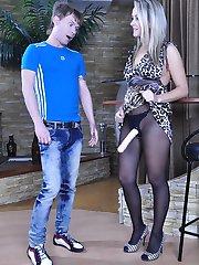 Brazen blonde brandishes her strapon cock ready to fuck her kinky boyfriend