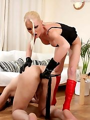 Brutal lady feeding her masked slave with strapon before exploring his ass