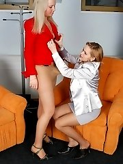 Lusty female co-workers in lacy hose having strap-on break right in office