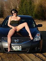Horny tease Sabrina shows off her tight pussy as she lifts her dress while on the hood of the...