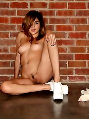 Sexy babe Zoey Violet strips naked and shows off her tight teenage pussy with a neatly trimmed...