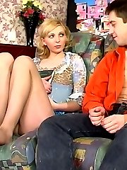 Blondie rubbing her clit while getting her nylon feet licked and fondled