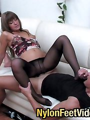 Sizzling hot chick opening guys mouth with her feet in black pantyhose