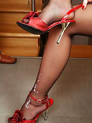 Kinky gal admires a fresh cum load on her nyloned feet in high heel sandals