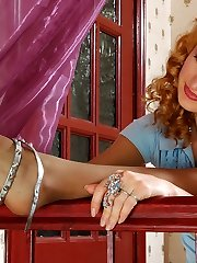 Cutie in expensive pantyhose dildotoying her pussy sitting on stair railing