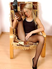 Randy chick in black pantyhose cant help pleasing herself on the armchair