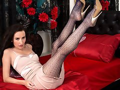 Sophia poses provocatively showing off her stunning legs and ass in sexy lacy pantyhose!
