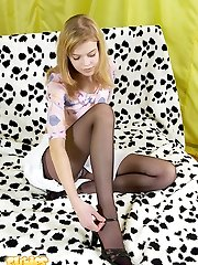 Little blondie takes off tights and satin panties
