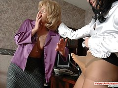 Nasty lady-boss seducing her mature secretary and getting hot pantyhose sex