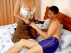 Old lady giving young guy a good thrashingbr