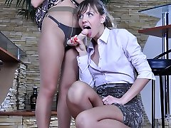 Strapon-armed lesbo blonde gropes and fucks another girl through pantyhose